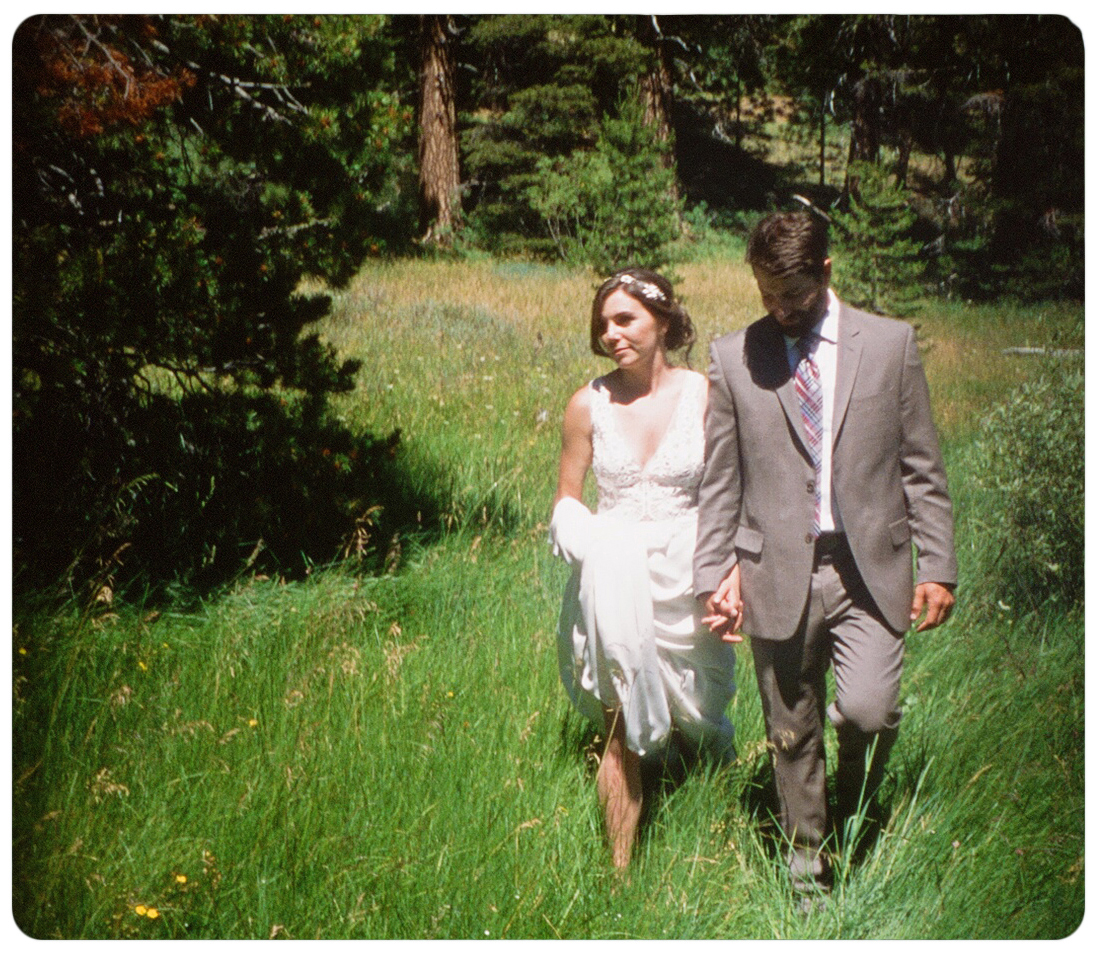 Colleen & Chris walking in long grass